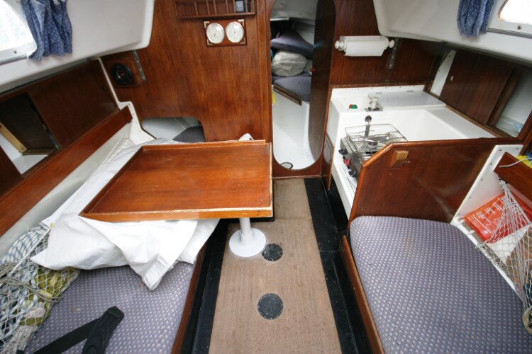 Master Marine Eygthene 24for sale The saloon table - With the galley to starboard