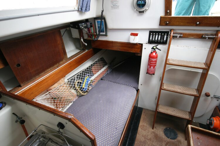Master Marine Eygthene 24for sale The starboard quarter berth - The navigation table is situated above this berth, it is in the stowed position.