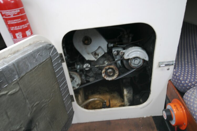Master Marine Eygthene 24for sale The engine compartment - There is more access from each quarter berth