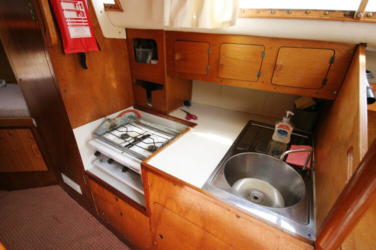 Colvic 26for sale The galley - This is located on the starboard side of the saloon, with ample storage