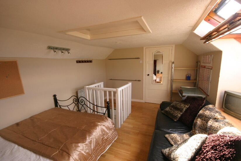 Western Isles Property -  House on the Isle of Lewisfor sale Loft room - Access door to loft storage space at end of room