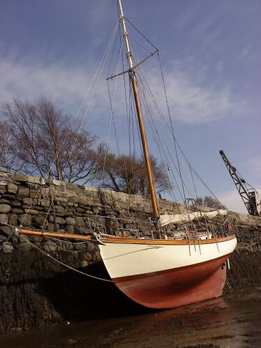 Wooden Classic Gaff cutterfor sale Dreva dried out alongside - Showing her long keel to good effect