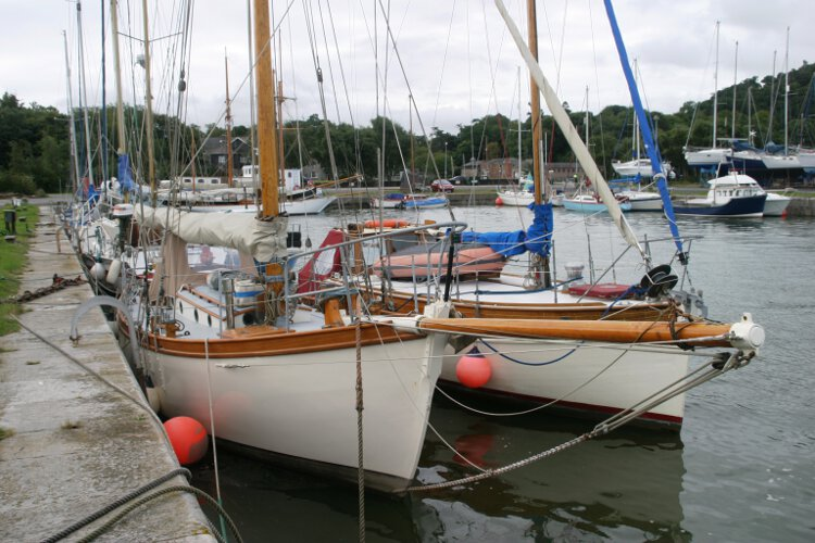 Wooden Classic Gaff cutterfor sale Seen from ashore - Note her bow sprit