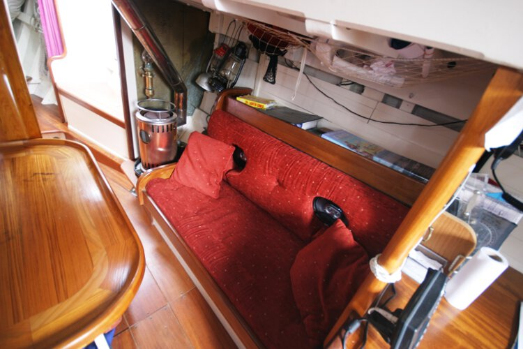 Wooden Classic Gaff cutterfor sale Saloon view - Showing the starboard settee berth, note the stove