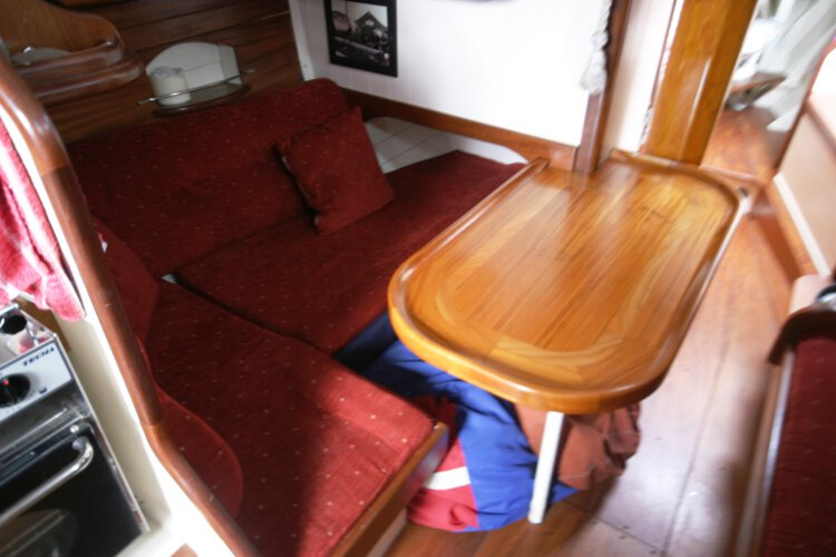 Wooden Classic Gaff cutterfor sale Saloon view - This is the port settee with the saloon table