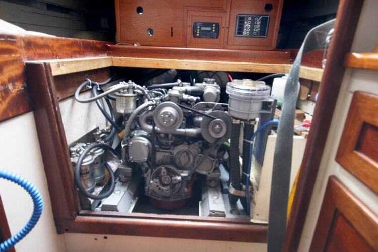 Wooden Classic Gaff cutterfor sale The engine compartment - Located under the companionway,