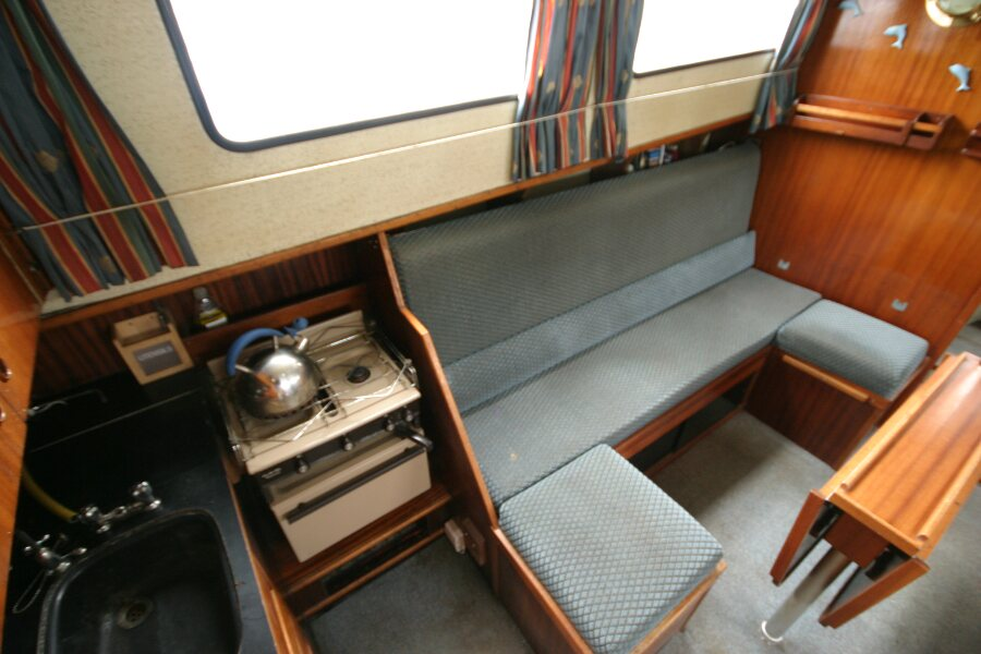 Finnsailer 35ft Motor Sailer Looking to port side of saloon from the companionway
