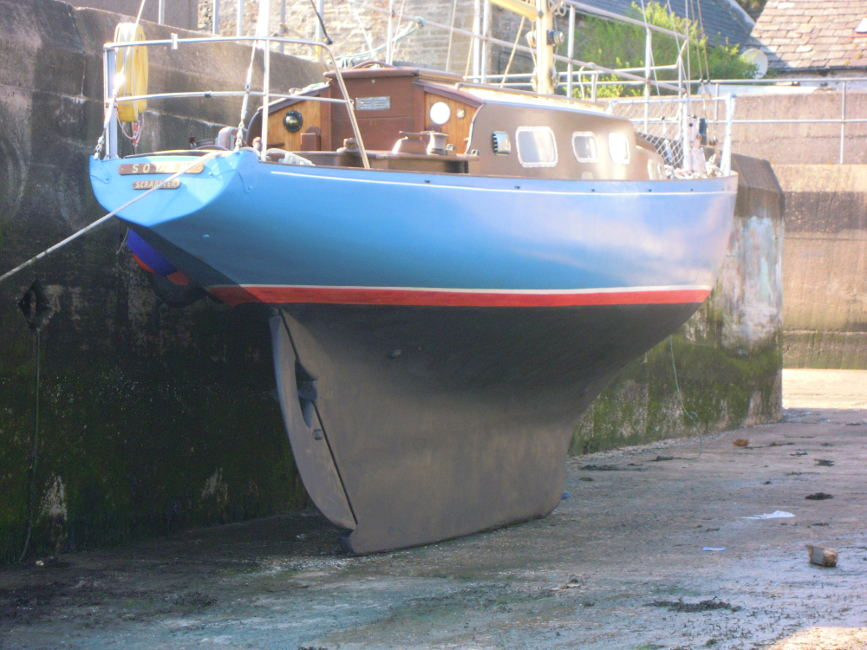 Wooden Classic 29 foot Bermudan Sloop Dried out for a scrub