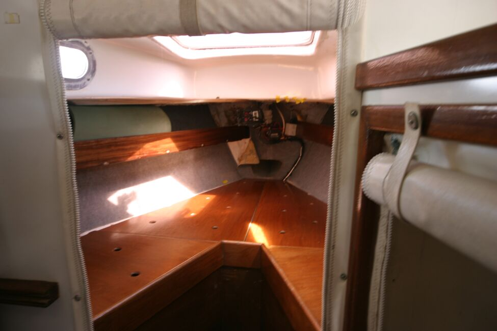 Contessa 32for sale Forward cabin entrance - heads to the left, wet locker to the right.
