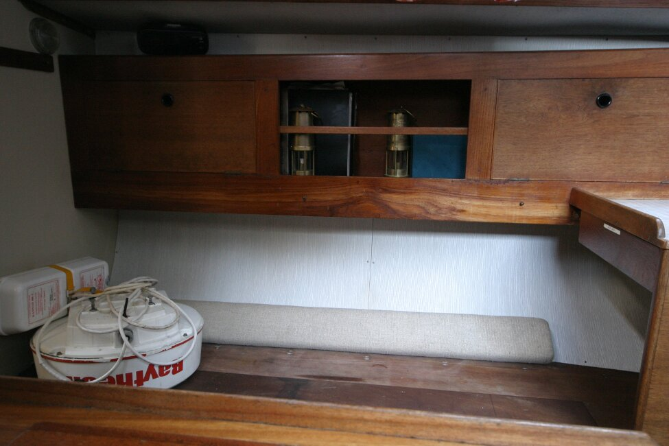 Nicholson 32 Mk Xfor sale Saloon - starboard seating and storage - Upholstery in storage.