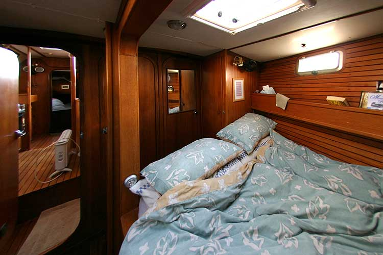 Jeanneau Trinidad 48 Ketchfor sale Double berth view forward - two doors access the saloon/galley area and one to the main heads.