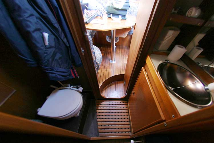 Jeanneau Trinidad 48 Ketchfor sale Heads of the aft port cabin - saloon visible through the door