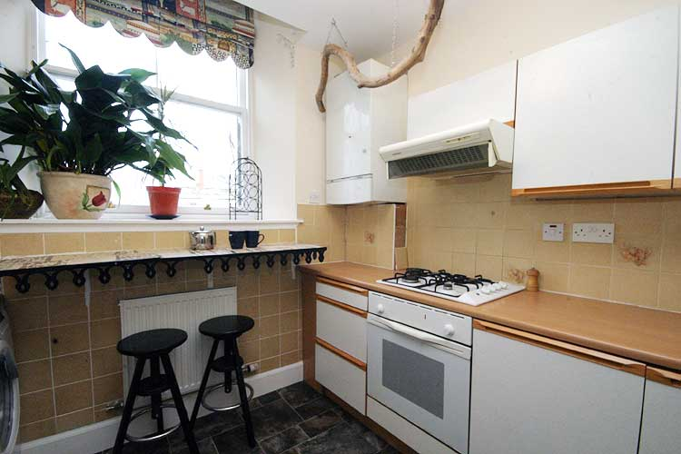 Waterside Property - 2 Bedroom Flatfor sale Kitchen - Fitted kitchen. Gas hob and electric oven. Combi boiler in the corner of the room.