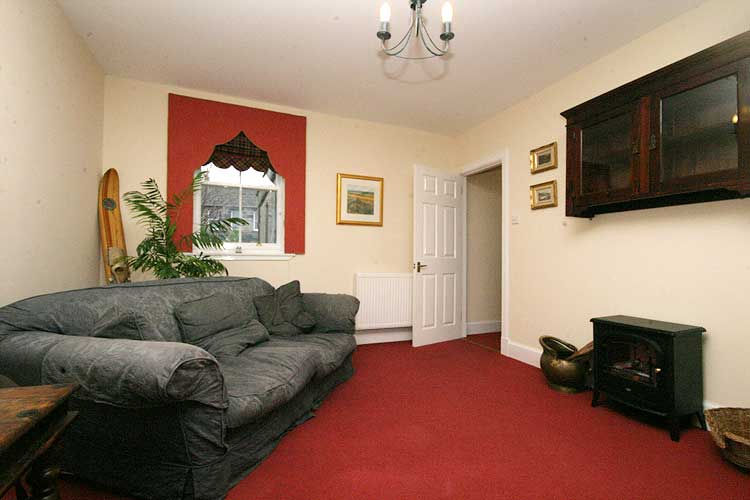Waterside Property - 2 Bedroom Flatfor sale Lounge - Showing rear aspect single window with views over the town square.