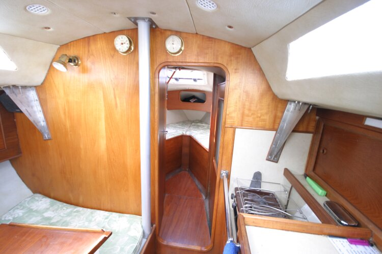 Colvic UFO 27for sale Looking past the galley area to the forward cabin entrance -